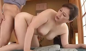 Beautiful asian older mom plays with water on her racy pussy and fucked hard by boy